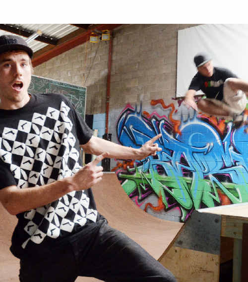 Bevan Newton at his 'Popsgood' indoor skateboard park at 2/16 Cook Dr, with Justin Carriage airborne.