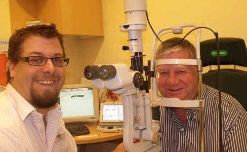 Specsavers optometrist Adam McDougall tests Mayor Col Meng's eyes on National Eyecare Day.
