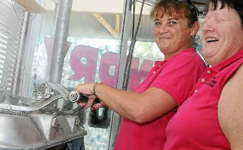 Gladstone Steam Laundry recently received an award for hiring disabled people. Sharee Burley works the steam press machine with owner Marilyn McBean.