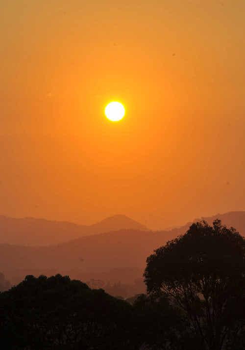 Coffs Coast Advocate photographer Bruce Thomas captured the setting sun, blazing through the smoke and dust haze.