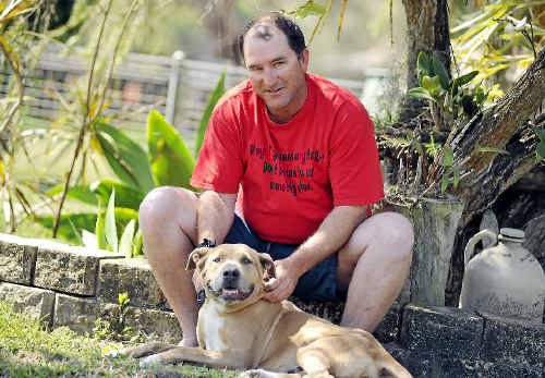 Jason Hodgson is delighted to have his pet dog Minnie back after she disappeared from his Yarwun home more than three months ago.