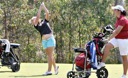 Beaudesert's Jaimee Dougan goes for the pin yesterday in the final round of the Sunshine Coast Junior Masters as Horton Park Golf Club's Lauren Mason looks on.