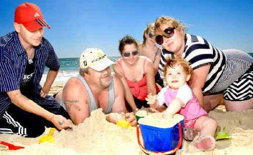 Stephen Reynolds, Darren Walker, Lorraine Conn, Jacqui Dickson, Jessie and baby Elizabeth Wallker at Coolangatta Beach.