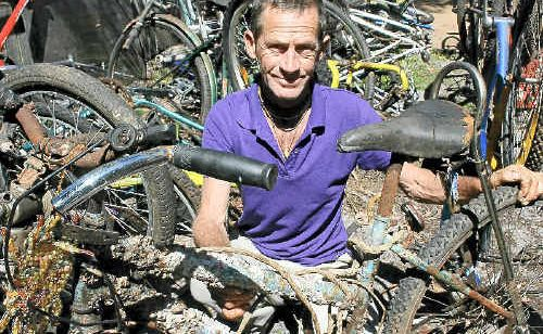 DESTINY: Mark Pate with his barnacle-encrusted bicycle. Photo: Gary Chigwidden.