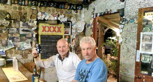 HERE'S CHEERS: The late Jeff Schneider (left) and Darryl Essery enjoy a beer on their recent holiday.