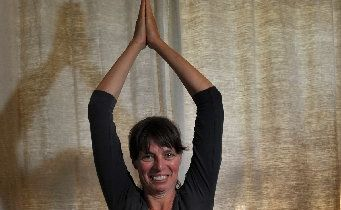 Yoga instructor Li Melville is training to be a yoga therapist.