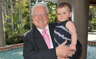 Telstra CFO John Stanhope with his granddaughter Kirra, at the Hyatt Coolum for a shareholder briefing.