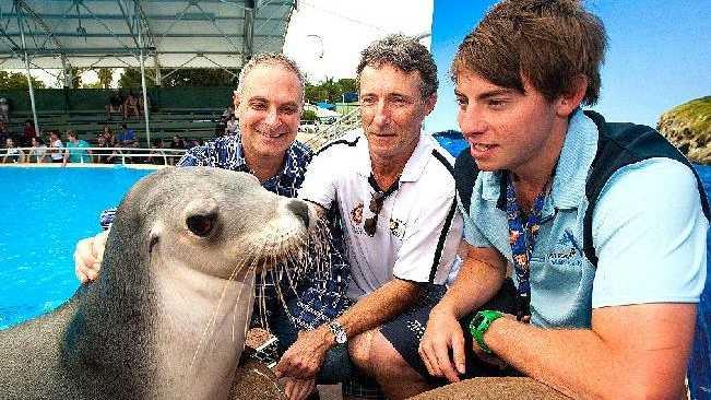 Rotary Daybreak's David Scham and Mark Spencer launch the Coffs Harbour Rymarine Program with graduate Ken Demaschke at Coffs Harbour's Pet Porpoise Pool.