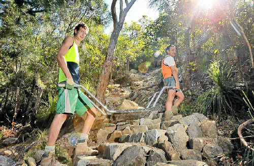 Alex Fishwick and Andrew Ferguson from Track and Trail Management Services work on the Mt Coolum track improvement.
