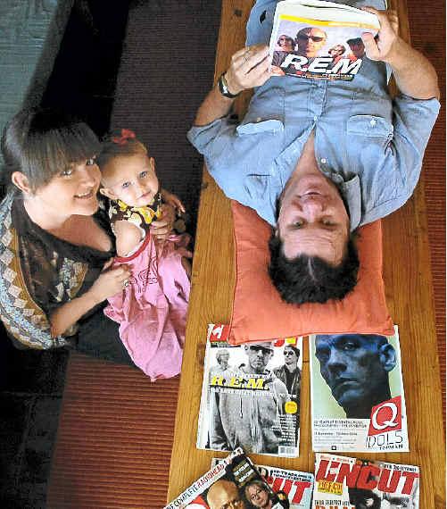 R.E.M. fan Bruce MacKenzie needs the support of family members Samantha Turnbull and Liberty MacKenzie, 18 months, after hearing the band has finally called it quits.