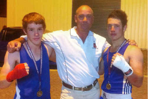 Boxers Matt Grant and Tristan Martin with Blair Wilson after winning gold at the state titles.