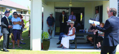 Auctioneer Simon Thomas calls for an increase on $380,000 at 59 Balgownie Drive, Peregian Springs, on Saturday.
