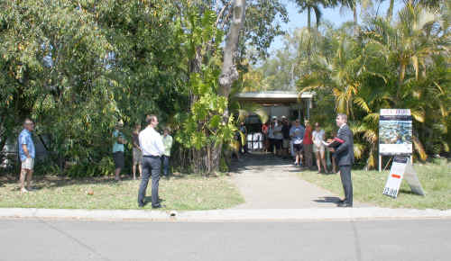 Auctioneer Michael Hughes held the auction of 13 Laburnum Crescent, Noosaville, on the streetfront in view of the river. The three bedroom cottage on 531sq m was passed in on a vendor's bid of $500,000. Scott Cowley and Dan Neylan of Dowling & Neylan will continue to negotiate before promoting a list price.