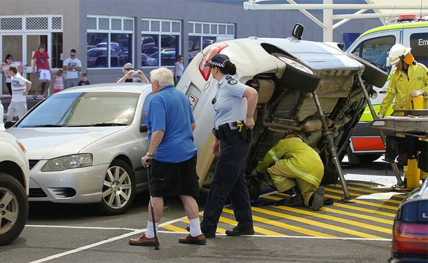 A car crashed in the Stockland Shopping centre at Caloundra. It ended up on its side wedged between a pole and a car.