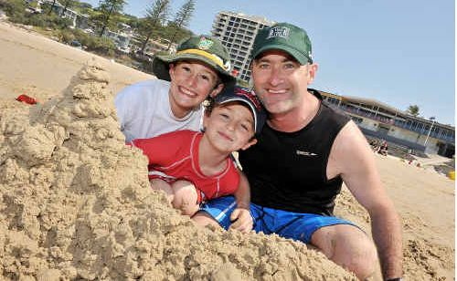 Enjoying pristine weather and calm conditions at Coolum Beach were Hayden, 9, Jason and Rod Llewellyn, 6.