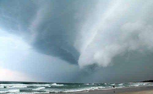Sharpes Beach as the storm brews overhead. P