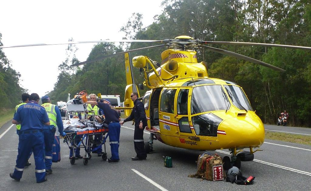 Rescuers at the scene of Saturday's accident on the Pacific Highway at Harwood, north of Maclean.