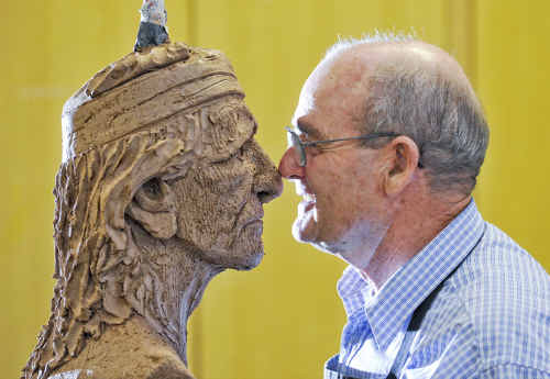 Fred Edwards of Tamworth gets close to his Indian bust work in the A Portrait Bust In Clay workshop at Artsfest.