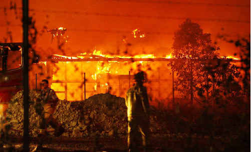 Fire engulfs buildings at the old North Ipswich Railway Workshops last night.