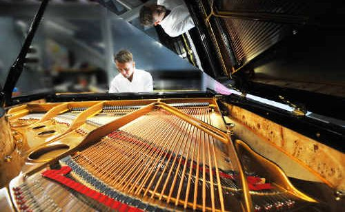 Pianist Adam Herd playing the new Bernstein CF168 baby grand at Reuben Fox Pianos.