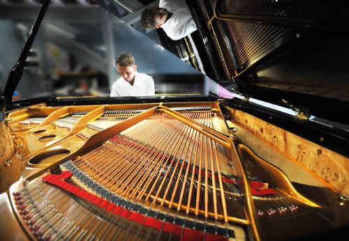 Pianist Adam Herd playing the new Bernstein CF168 baby grand at Reuben Fox Pianos.