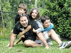TREATMENT WORKING: Brad Gibson enjoys playing with his children Jesse, 12, Daniel, 10, and Elissa, 7, during a brief visit to home, before returning to Florida to continue treatment for Pompe disease.