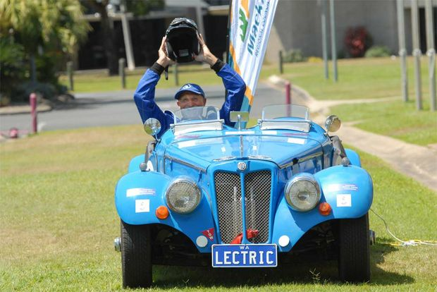 Glen George is powered up in his electric car in Mackay.