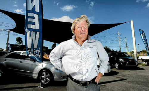 Hinterland Toyota dealer principal Tony Stark with new cars from Japan.