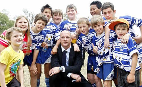 Broncos legend Darren Lockyer with the Brothers Junior Rugby League Football Club kids at Blacksoil where his name adorns the highway.