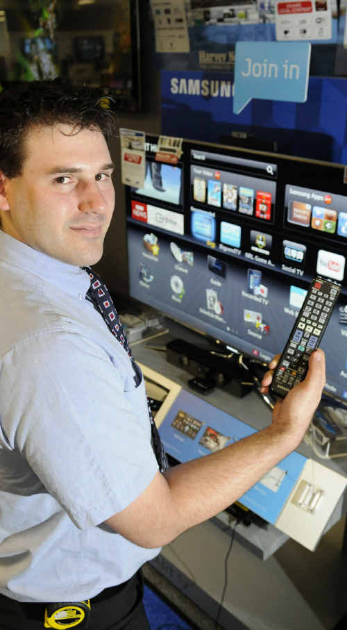 SMART TELLY: Harvey Norman salesman Andrew Erlandson shows the basic differences between one Smart TV and the next.