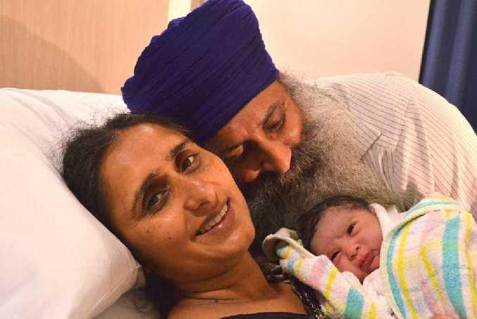 Cr John Arkan and his wife, Surinder Kaur, with their newborn. Photo: ELLEN KOESTER.
