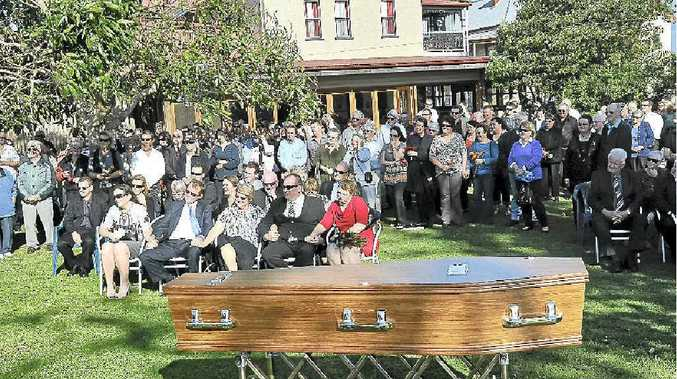 Mourners gather in the grounds of The Commercial Hotel, Ulmarra, for the funeral of former publican Bill Studd.