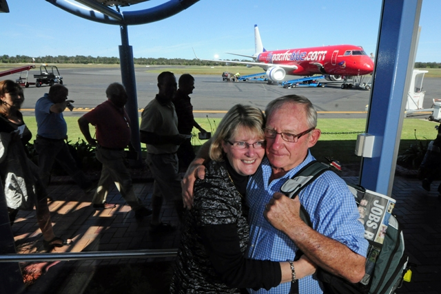 HAPPY TO BE HOME: Fly-in/fly-out mine worker Greg Baldwin and wife Roz hope Coffs Harbour can become a mining transport hub. Photo: ROB WRIGHT.