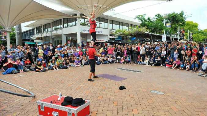 Buskers perform for the school holiday crowd in the City Square, Coffs Harbour.