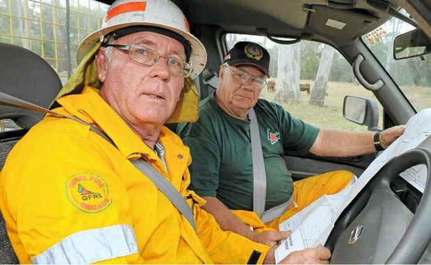 Phillip Kelly and Bob Muir look at a map of the region before heading off to a Tablelands Rd fire.