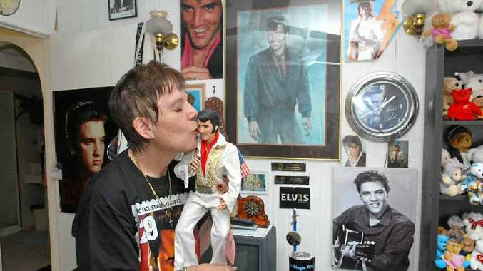 Mackay resident Susan Kynaston loves her Elvis doll, just one of more than 100 pieces of memorabilia.