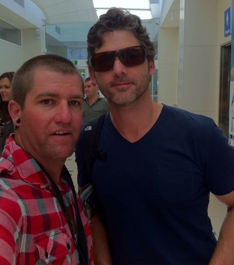 AUSSIE LAD: Actor Eric Bana obligingly poses for a snap with Ash Brown at Sunshine Coast Airport.