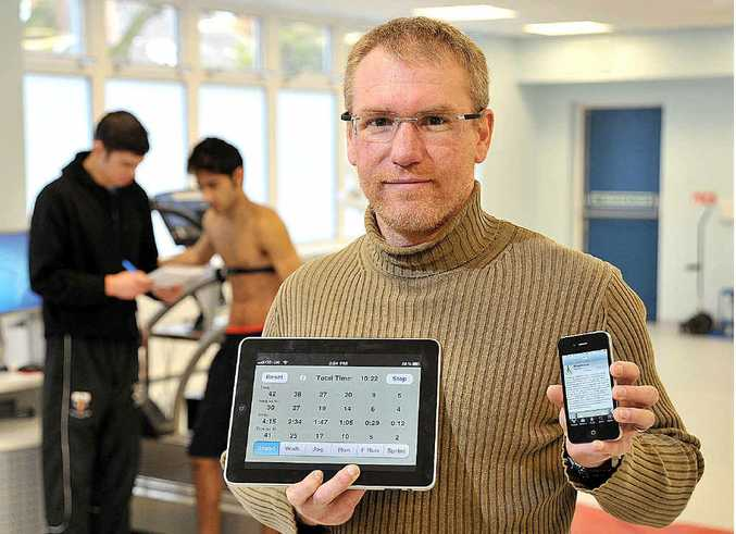 Former Maryborough soccer player Dr Grant Abt with the iPad application he's developed for English Premier League club Liverpool.