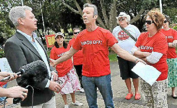 Kin Kin Community Group members bail up Cr Lew Brennan outside the Caloundra Council Chambers.