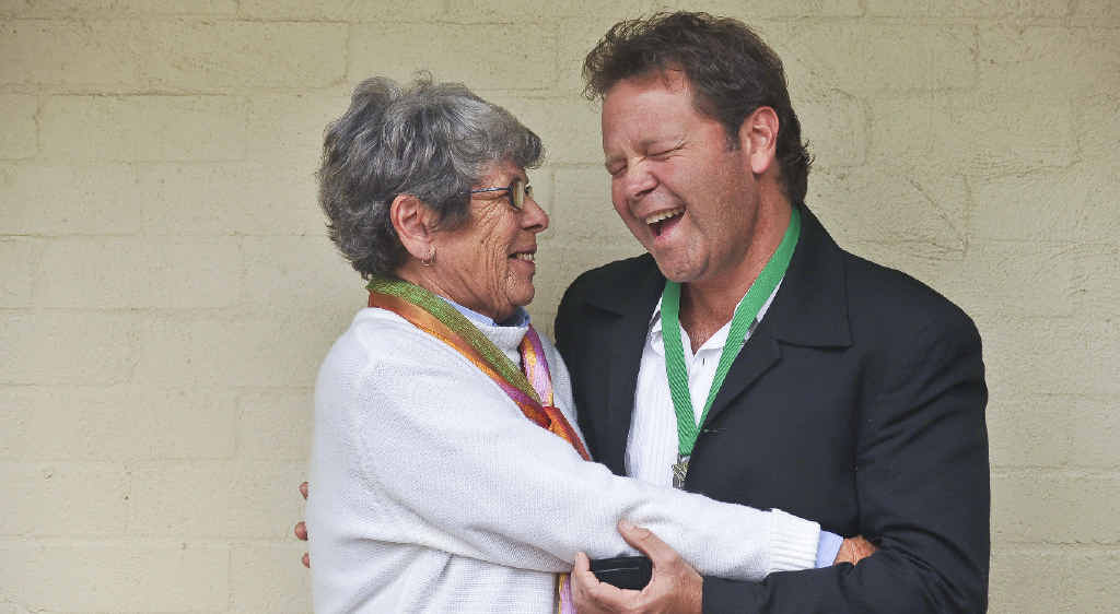 Irene Daley gives her son and new Clarence Valley ambassador Troy Cassar-Daley a congratulatory hug after the announcement at the Grafton Regional Gallery.