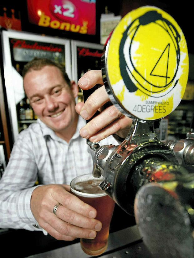 Wade Curtis of Peak Crossing pours his 4 Degrees Summer Wheat Beer at the Yamanto Tavern.