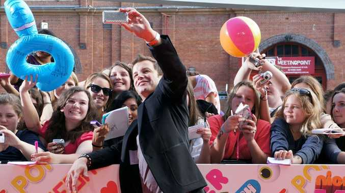X Factor host Luke Jacobz meets fans on the Orange Carpet of the 2011 Nickelodeon Kids' Choice Awards in Sydney.