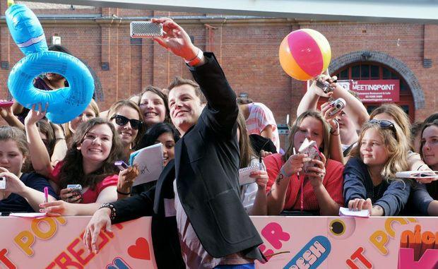 X Factor host Luke Jacobz meets fans on the Orange Carpet of the 2011 Nickelodeon Kids' Choice Awards in Sydney.