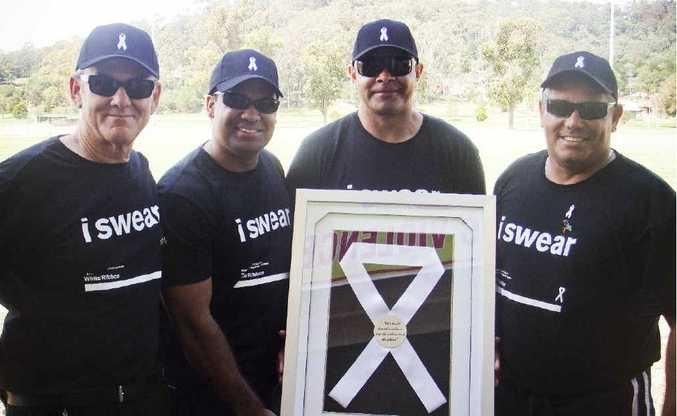 North Coast Community Health drug and alcohol counsellor Lee Love, Dallas Waters, former St George Dragons winger Nathan Blacklock, and Ricky Binge at yesterday's White Ribbon Day celebrations at Wherrett Park.