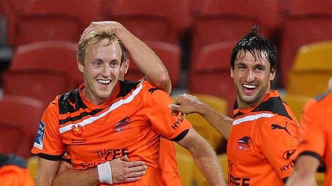 Mitch Nichols (l) celebrates scoring the winning goal.