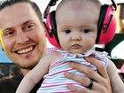 Rob Burr with his daughter Aylah (5months) at the Caloundra Music Festival.