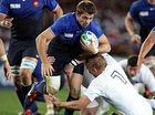 France's Vincent Clerc is toppled at Eden Park.