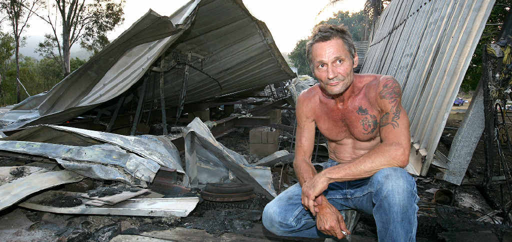 Dimitri Vogiatzis looks at his Mt Dukes home of thirty years that was burnt to the ground yesterday afternoon.