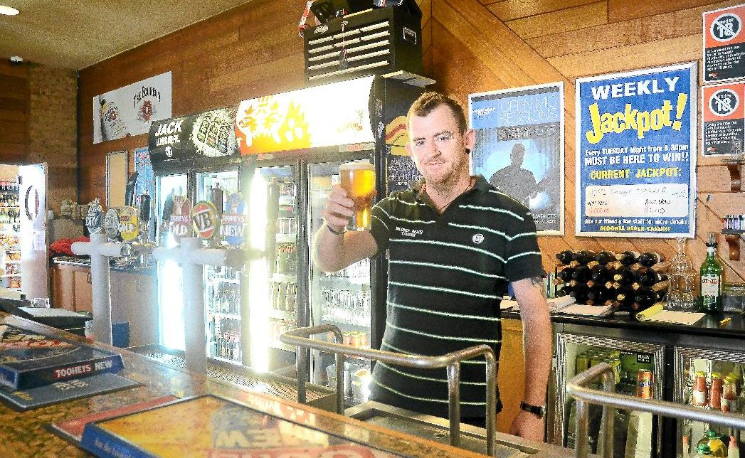 Bartender Rick Benton is still pulling beers at the Moonee Beach Tavern.