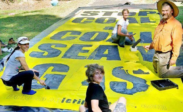 Making the banner, from left to right: Rachael Hansen, Huon Farnworth, Sara Bruxner and David Farnworth.
